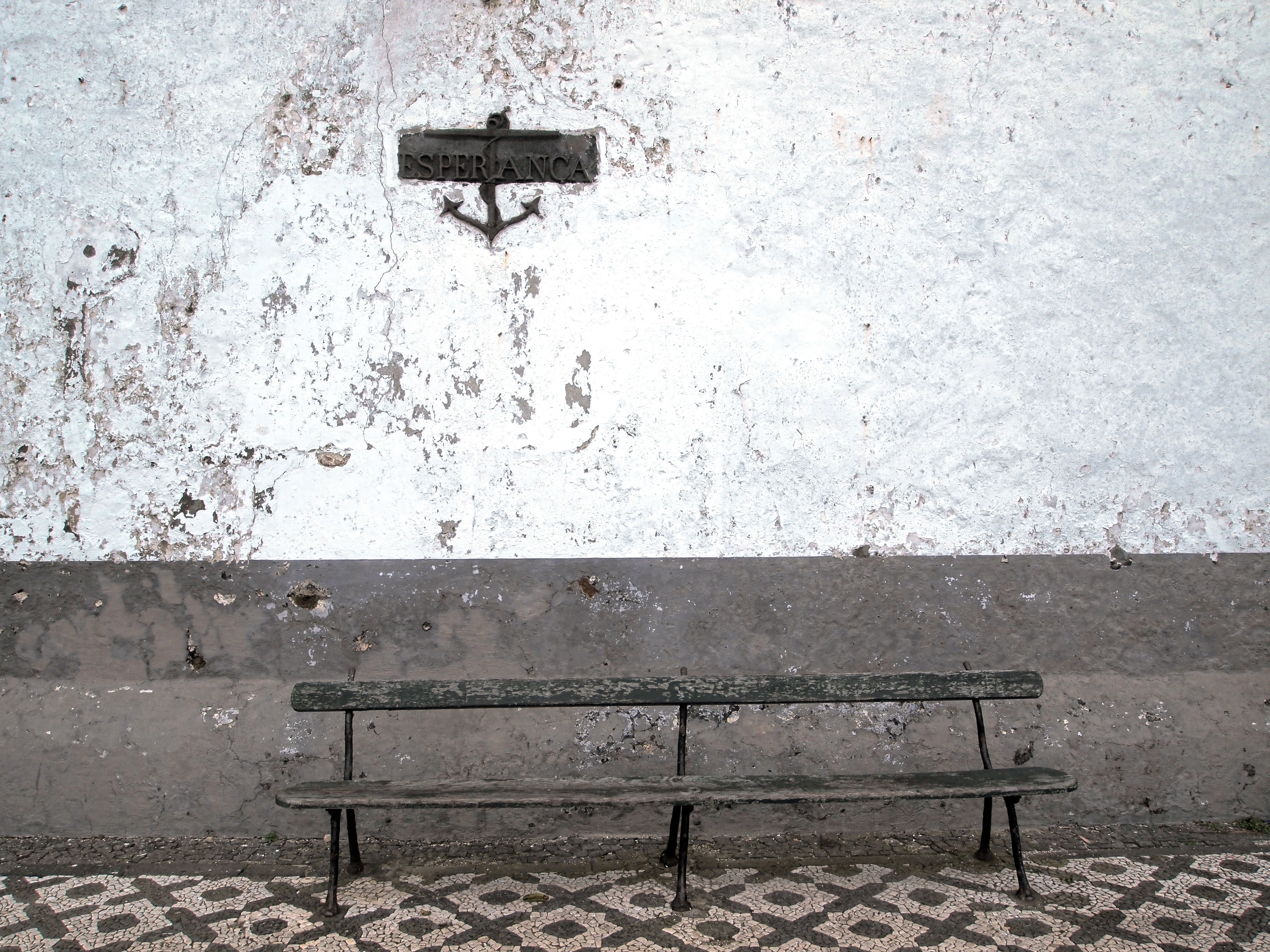 bench, bank, wooden sides, white wall, anchor