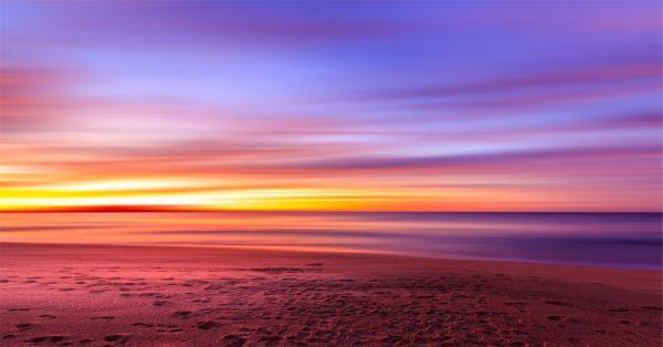 Sunset on the beach, sunset, purple, sky, beach, sand, footprints, shore, water, ocean, sea, horizon
