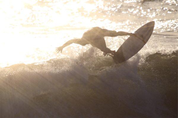 Surfing, surfer, surfboard, sunset, sun rays, waves, ocean, watersports
