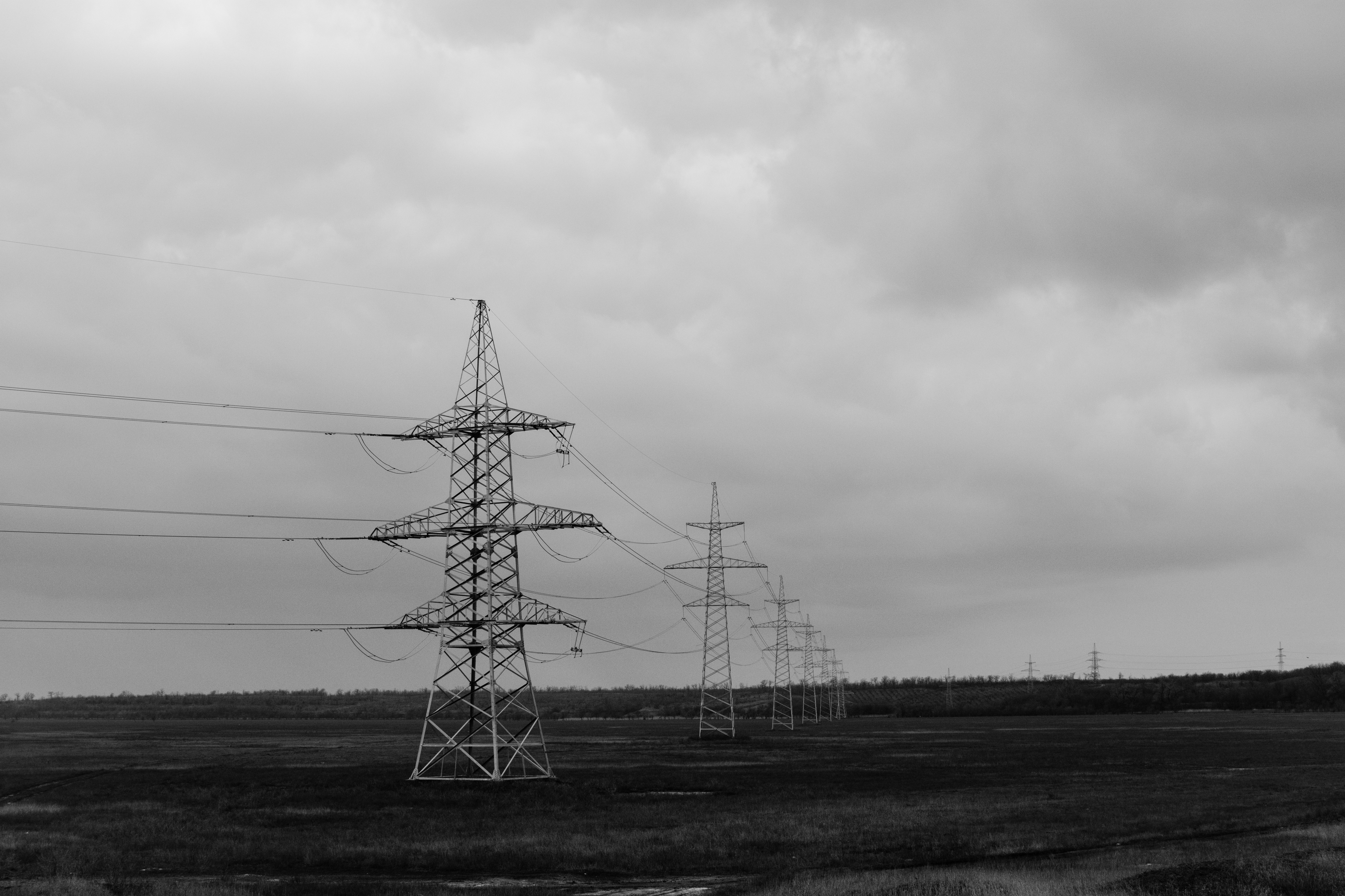 High voltage line, power lines, electrical, fields, grass, clouds, black and white, gray, tower