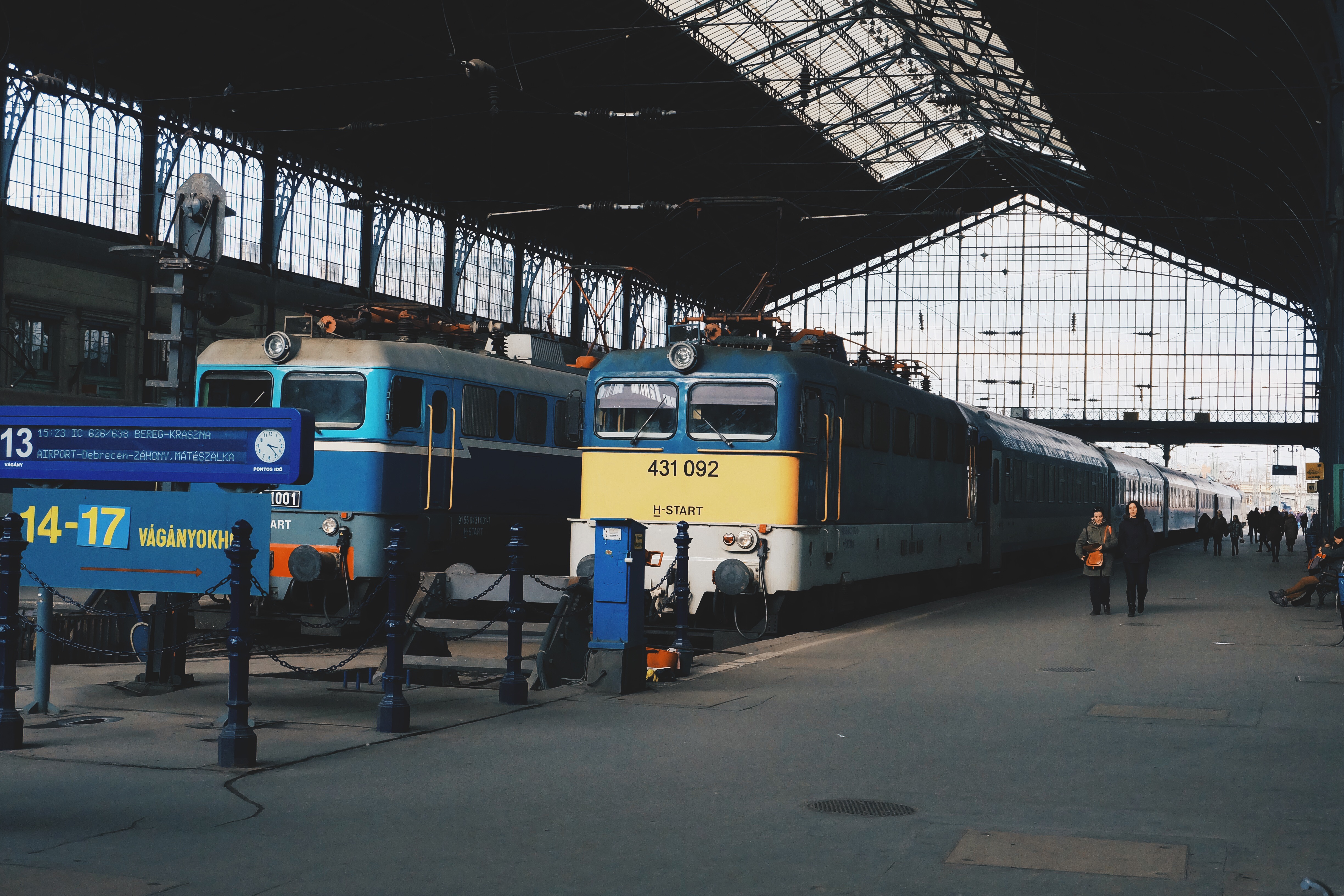 Railway station, trains, train station, transportation, people, machines, barn