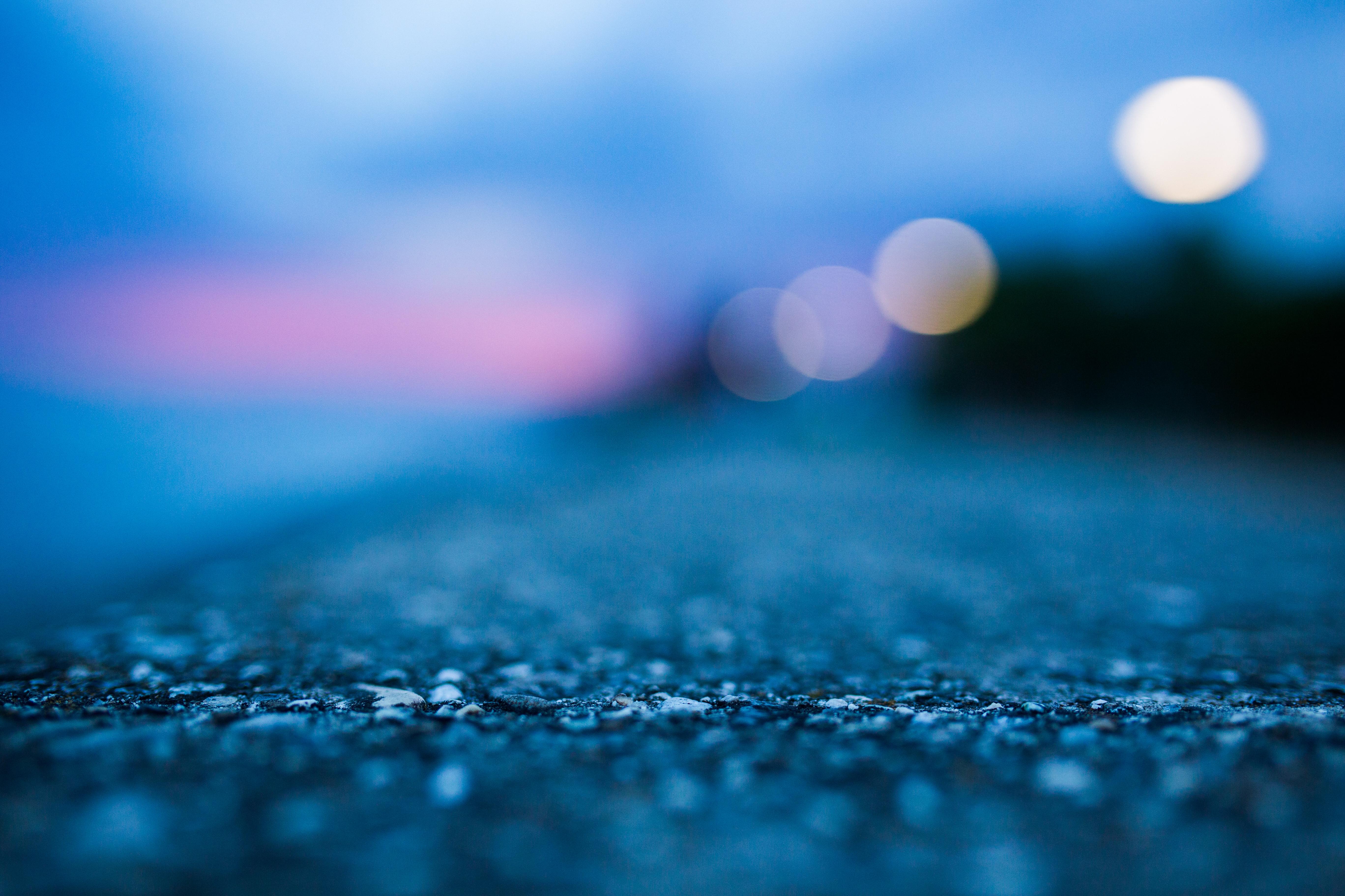 Close-up of concrete, asphalt, blue, light, morning, blurred, bokeh, concrete, lake, raining, rocks, storm, Sun, sunset, view.