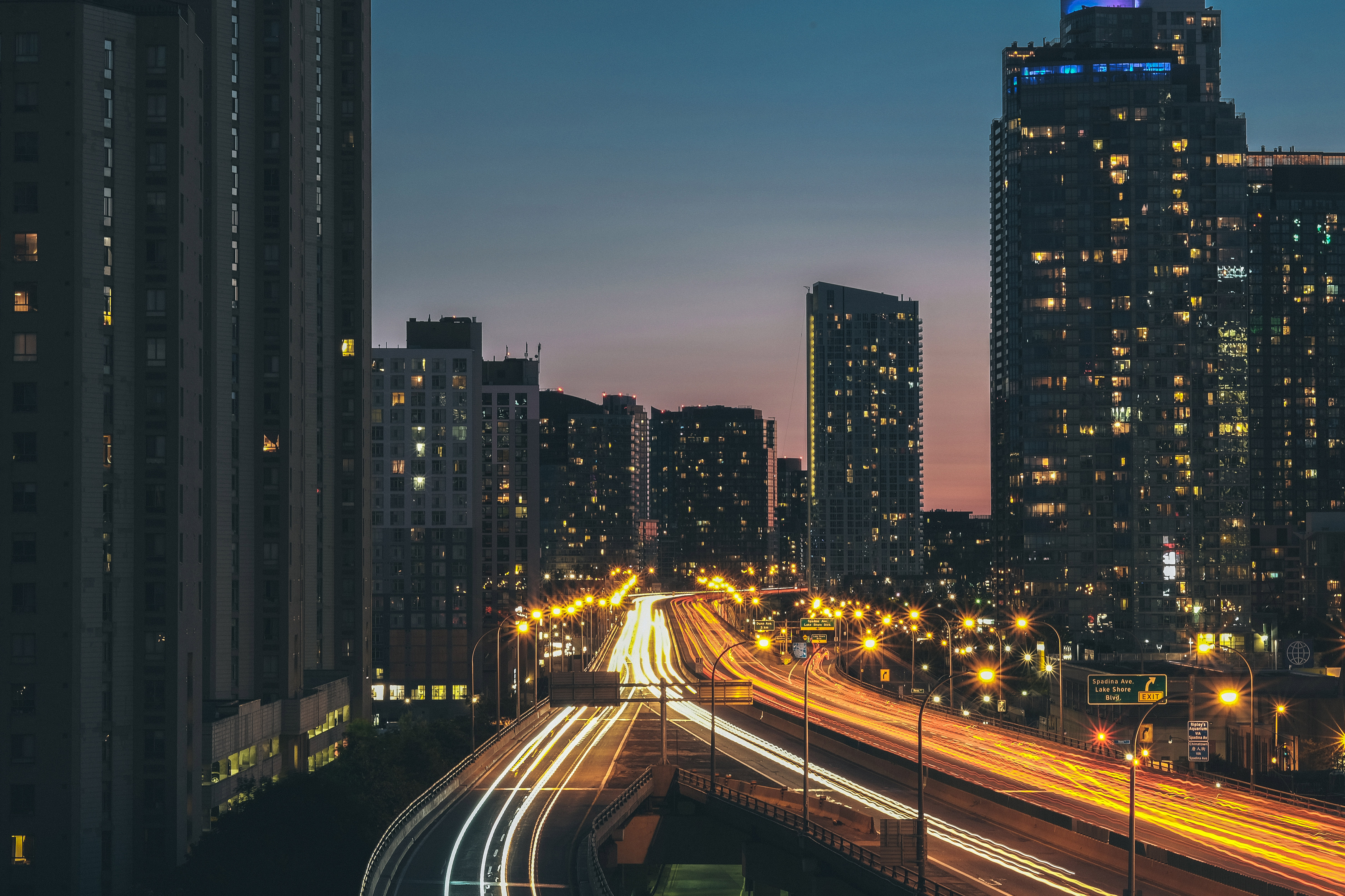 Moving city, buildings, light, light rays, cars, cars, speed, motion, lights, cityscape, skyline, buildings, architecture, towers, high rises, city, urban, night, evening, lights, road, streets, highway , cars, traffic, sky, dusk
