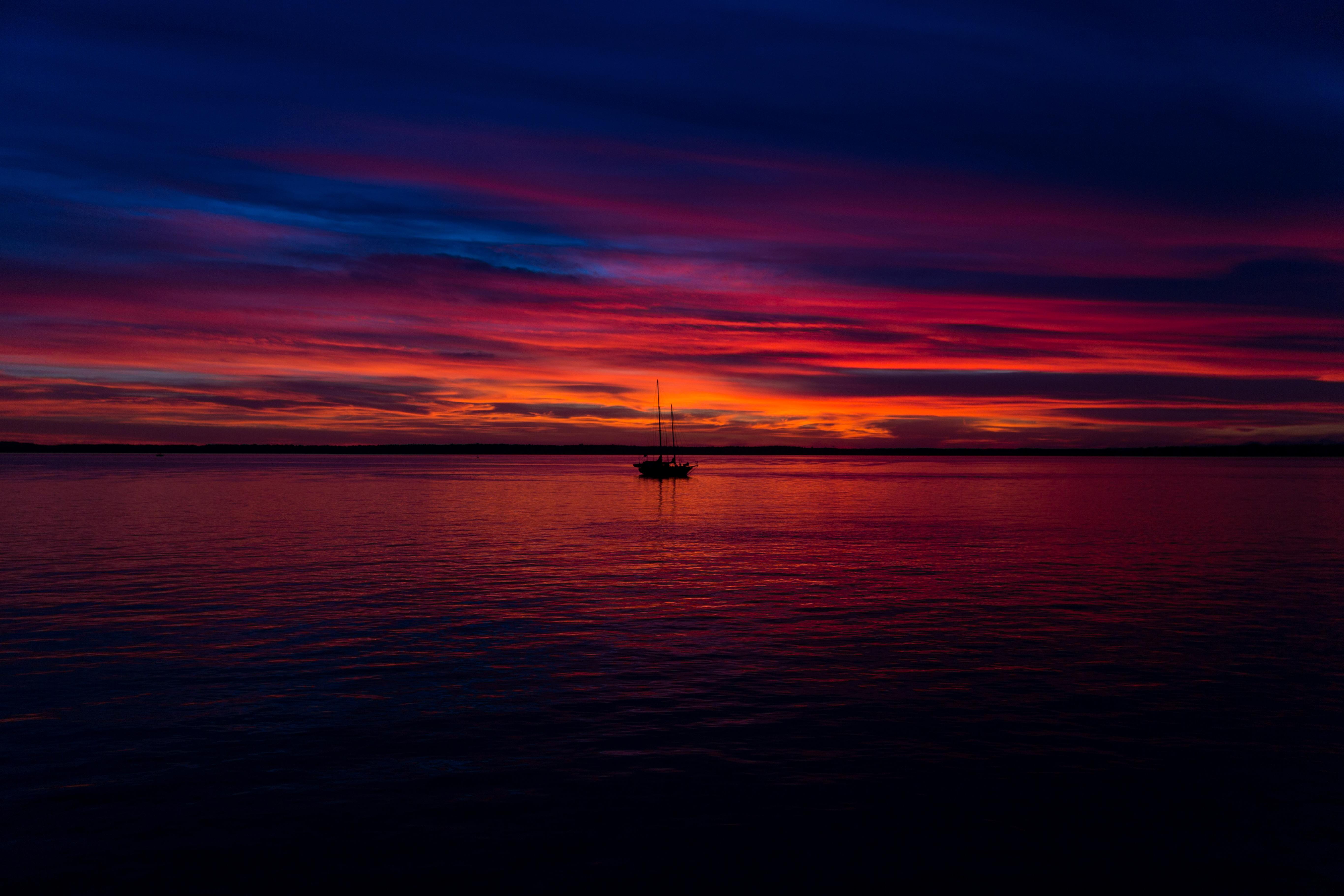 Sailing on the lake at sunset, boat, sailboat, sunset, sun, light, sky, cyan, orange, horizon, boat, nature, outdoors, night, evening