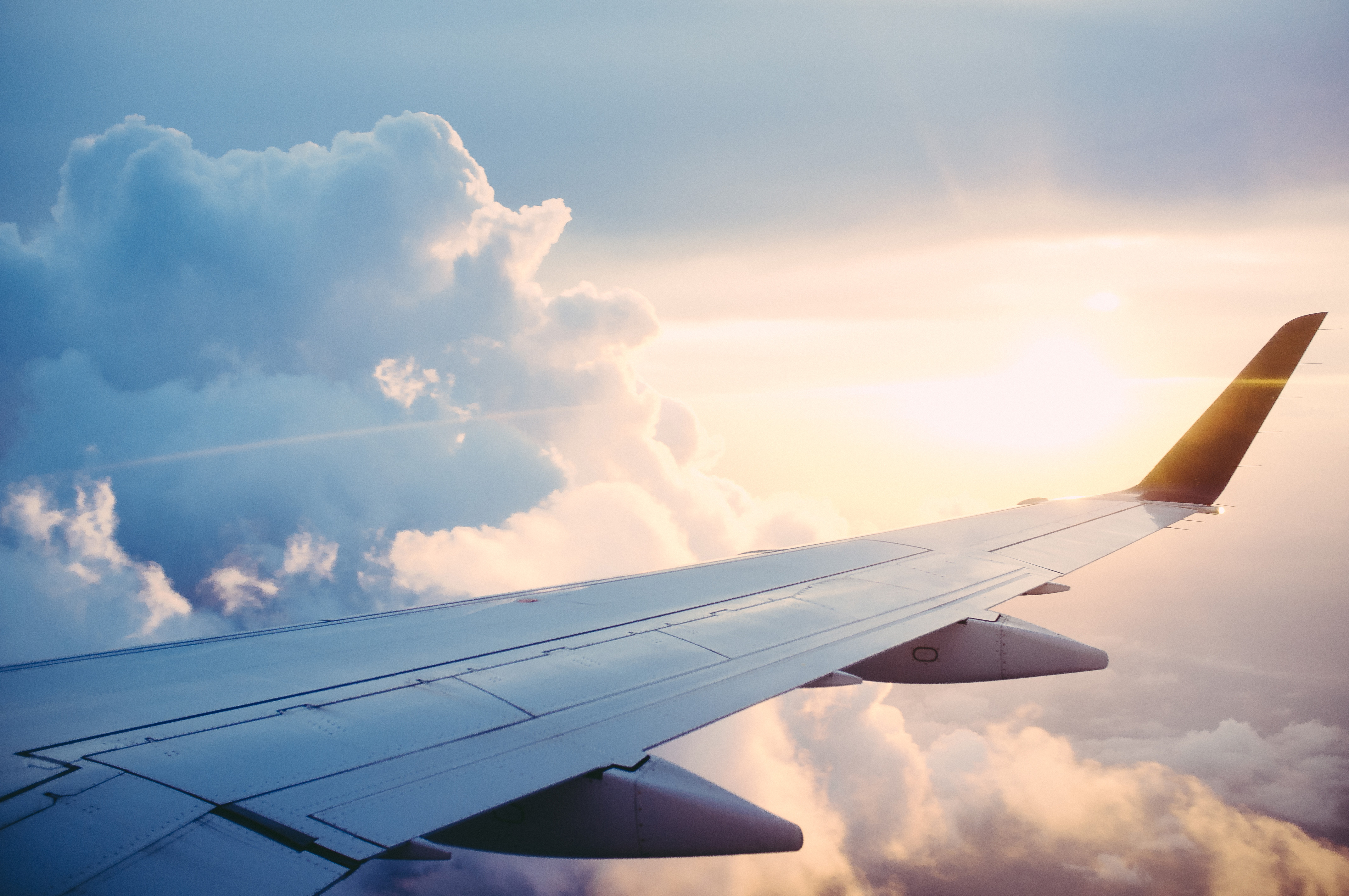 Wing aircraft in flight, airplane, wing, flight, flying, travel, transportation, sky, clouds, sunset, aerial, view