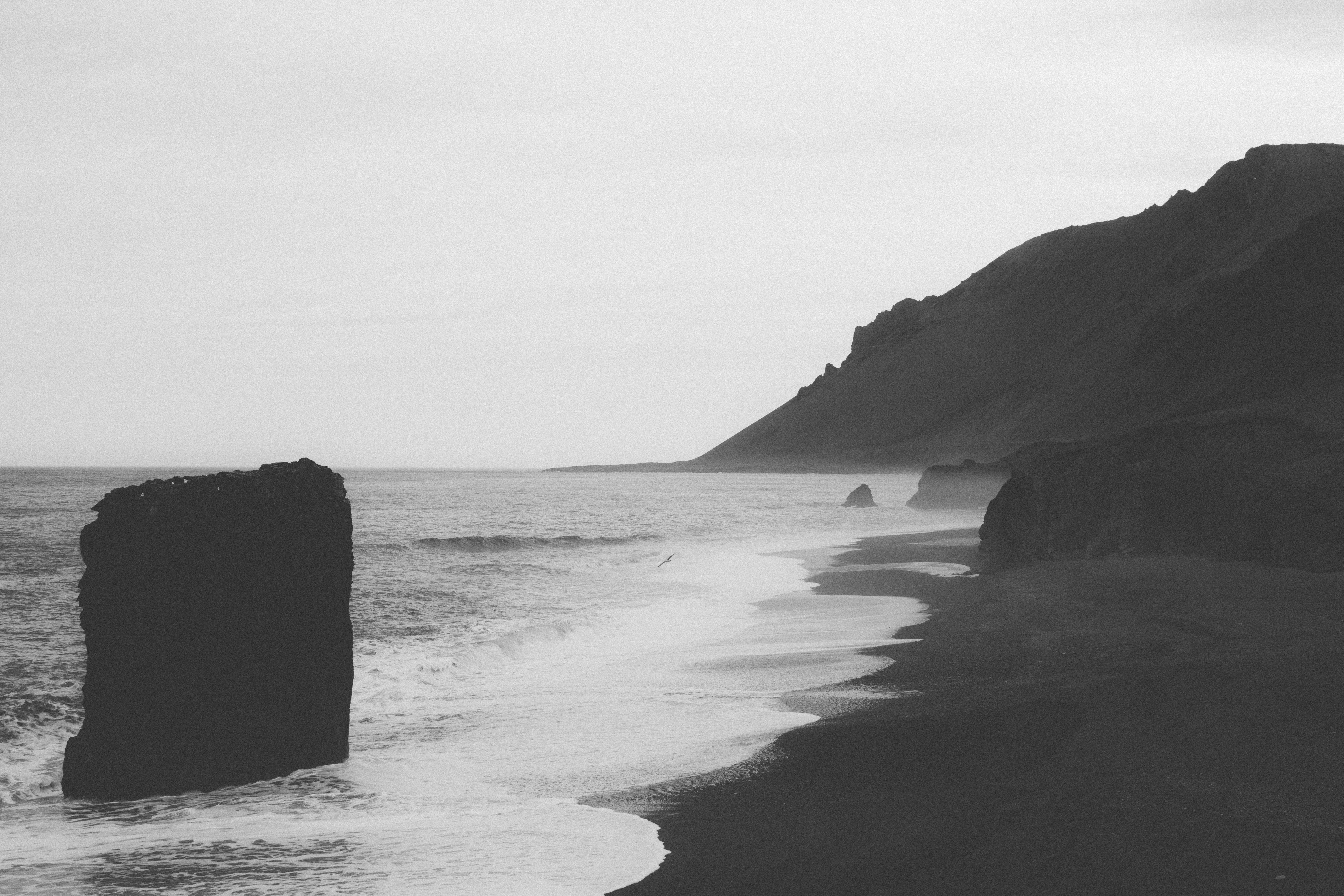 Shore, coast, beach, rocks, cliffs, black and white stones, cliff