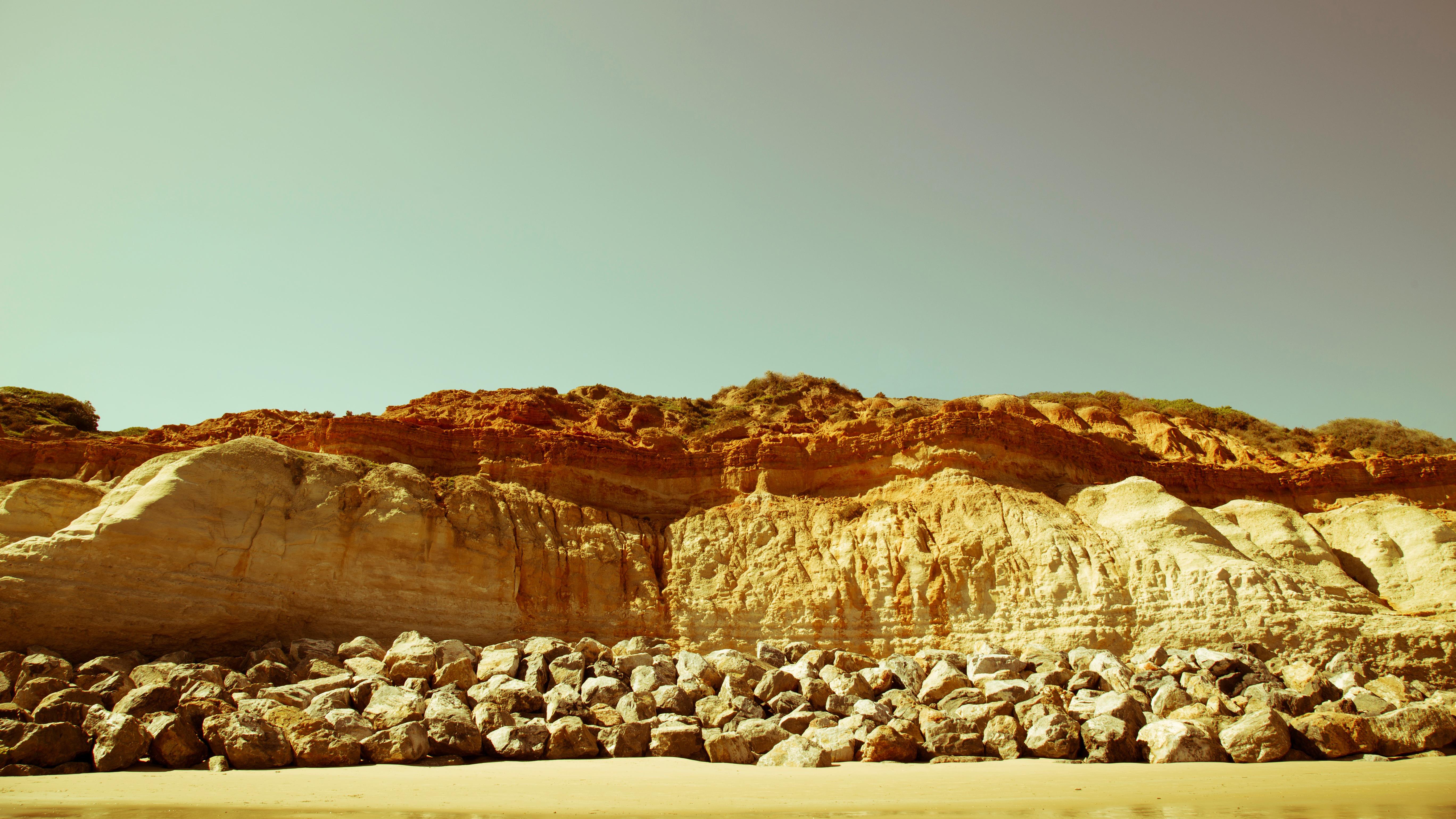 Rocky cliff, beach, sand, rocks, shore, sky, summer, sunshine