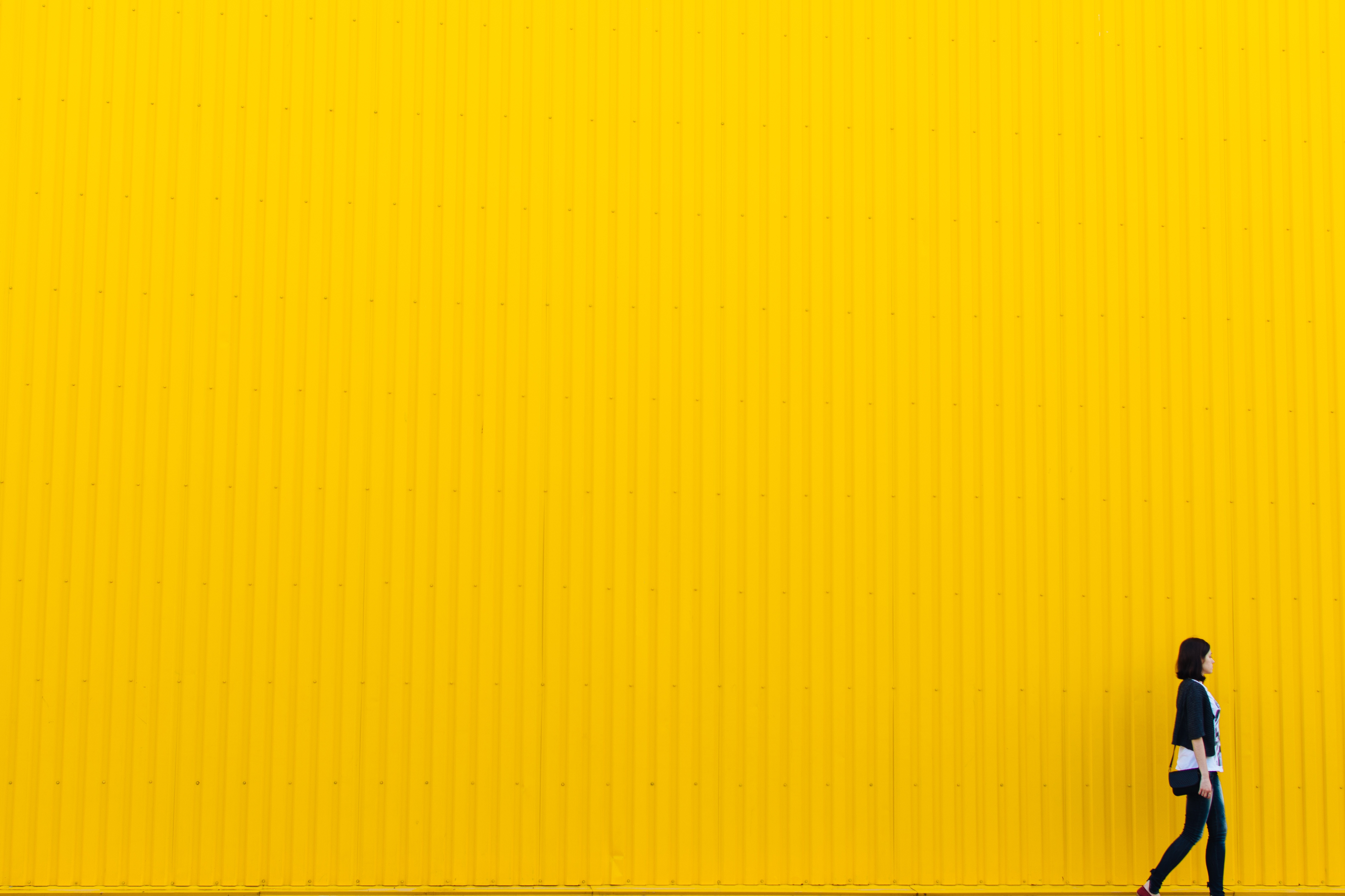 yellow background, woman, walking, color
