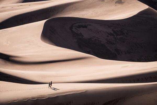 Walking through the vastness of the desert, heat, walk, people, dunes, sand, desert