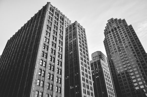 Buildings in black and white, towers, buildings, skyscrapers, architecture, brick, windows, city