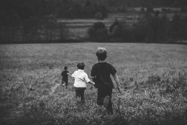 boys running, fun, field, black and white, running, playing, children